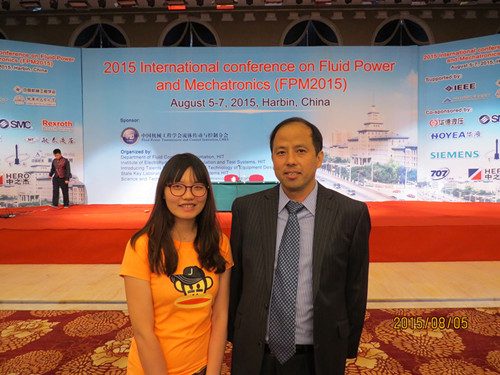Hua-yong Yang and the editor in FPM2015